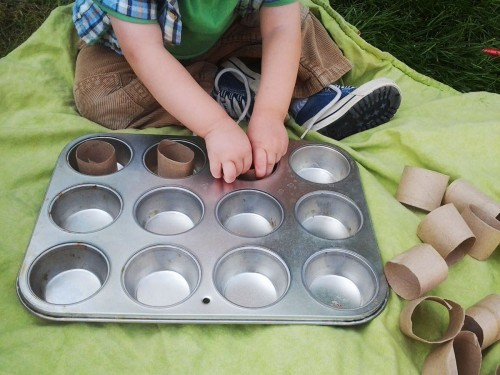 Toddler Activity that teaches one to one correspondence. All you need is a muffin tin and a paper towel roll cut into small pieces!