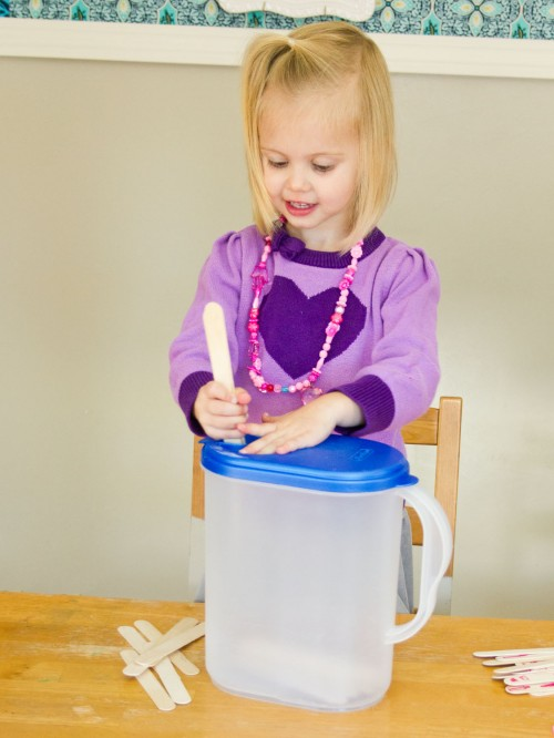 Easy Toddler Activity Idea: Popsicle Sticks in a Milk Jug