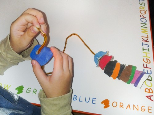 Toddler Activity Idea: Bead painted egg carton pieces onto a shoelace