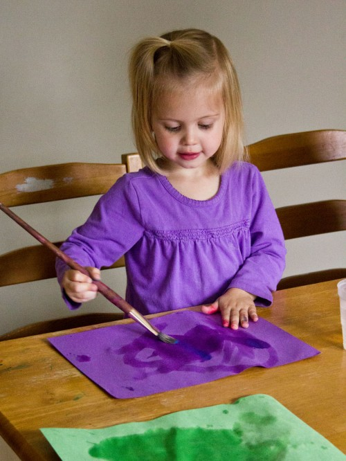 Water painting is a fun and super simple activity for toddlers. You just need construction paper, paintbrushes, and a cup of water.