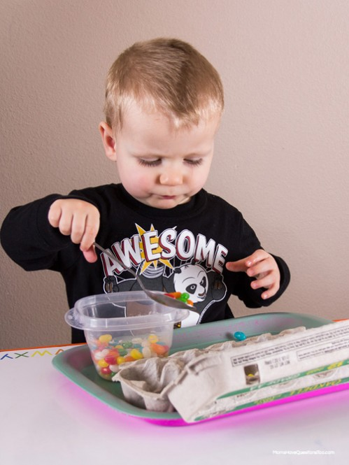 Spoon Jelly Beans into Egg Carton - Easter Themed Tot School Trays -- Moms Have Questions Too