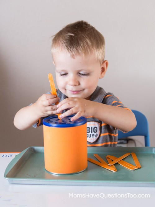 Putting Popsicle Sticks in a Can for Orange Tot School Trays - Moms Have Questions Too