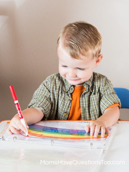 Coloring the rainbow in the toddler learning notebook - Moms Have Questions Too