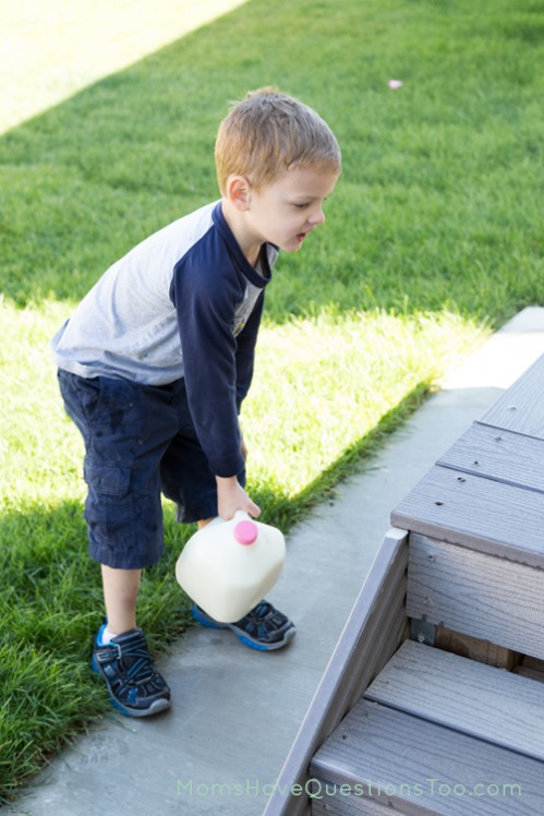 Lifiting milk jug onto porch - Moms Have Questions Too