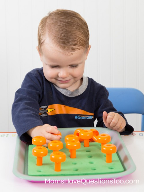 Pumpkins in a Garden on a Peg Board - Moms Have Questions Too