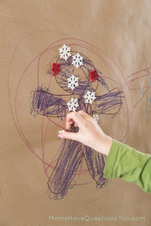Use Christmas stickers on your Christmas wall mural - Moms Have Questions Too