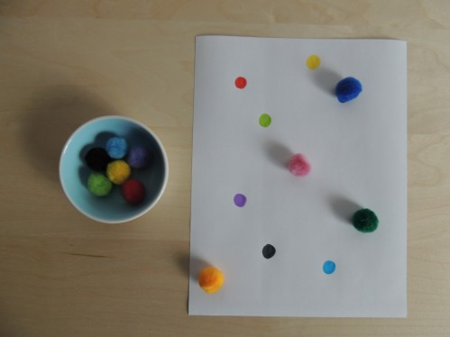 Match pompoms to colored dots on paper