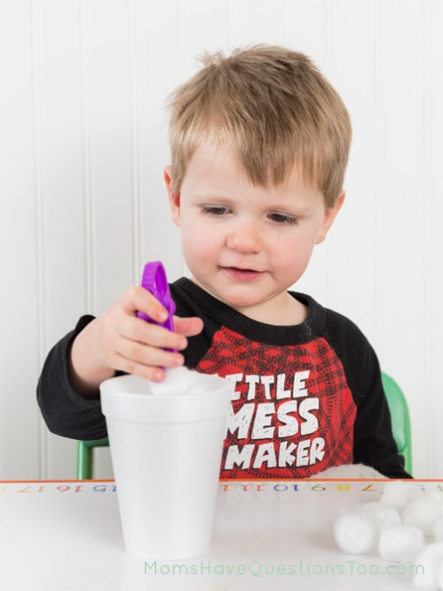 Transfer cotton balls to cup using kid tweezers - Moms Have Questions Too