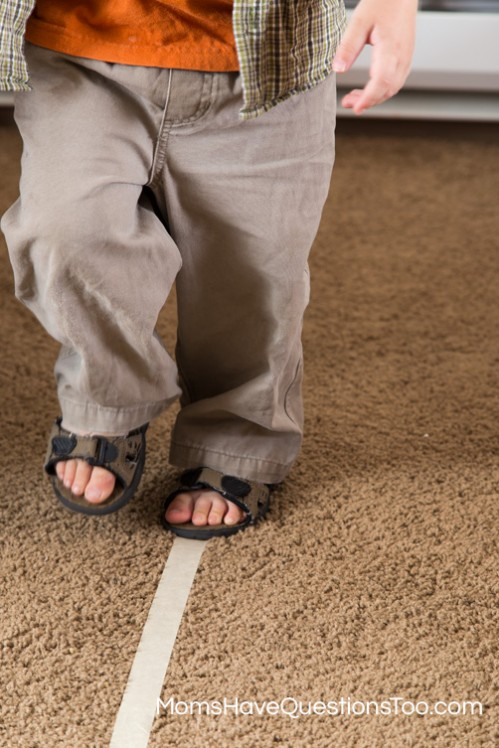 Practice walking on a straight line to develop gross motor skills - Moms Have Questions Too