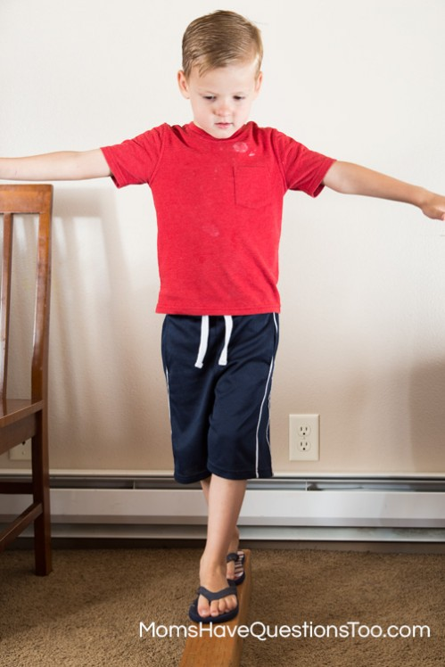 Walking on a balance beam to develop gross motor skills - Moms Have Questions Too