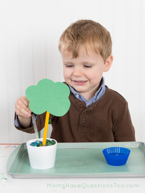 Watering an apple tree fine motor activity - Moms Have Questions Too